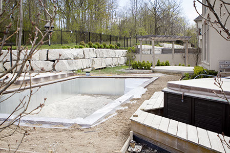 An Empty Pool being installed