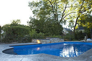 Blue Crystal Clear Swimming Pool with Rock Waterfall, Beautiful Backyard built by Flandscape in London Ontario
